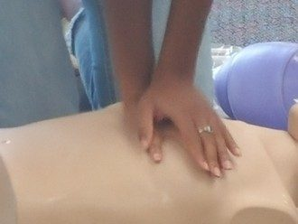 cpr dummy chest compressions